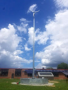 Solar wind turbine hybrid monopole. Clean energy. Renewable power systems - ARE Telecom & Wind