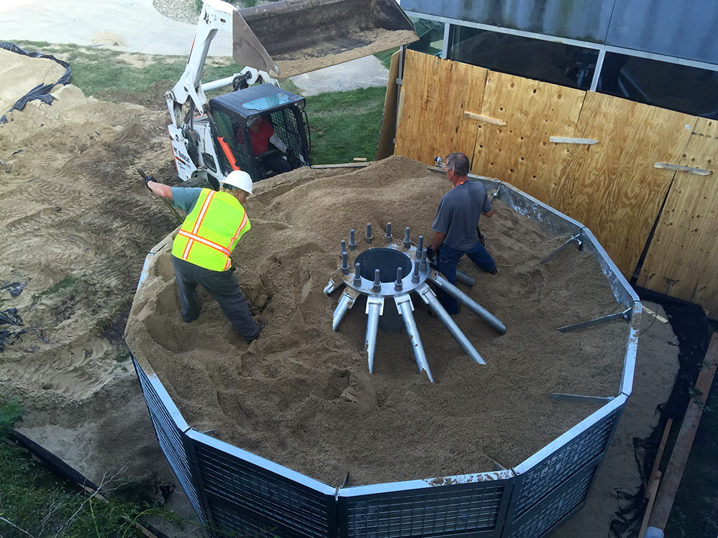 temporary or permanent, sand ballasted tower base structure